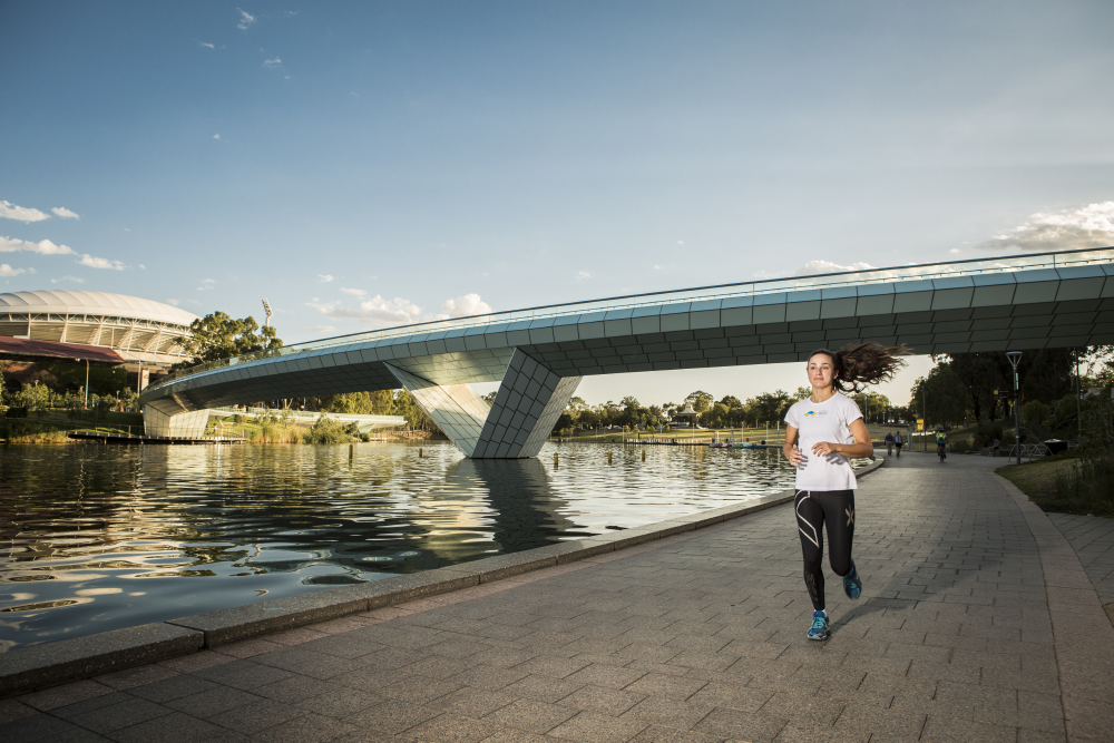 Adult running near River Torrens, Adelaide